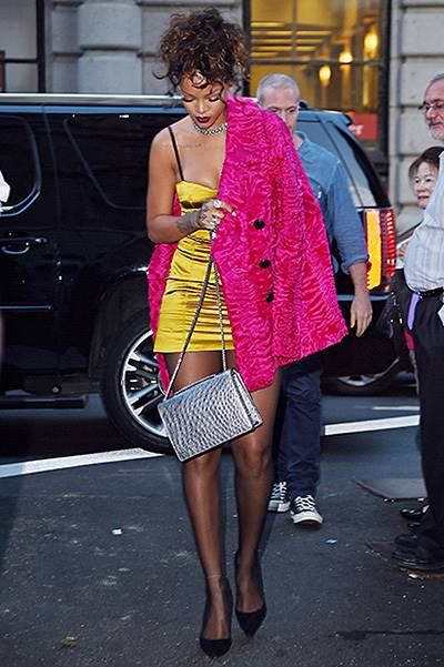 Rihanna looks stunning as she steps out in a mustard mini dress and bright pink coat as she heads to a dinner at Nobu restaurant with her BFF Melissa Ford in Tribeca, NYC