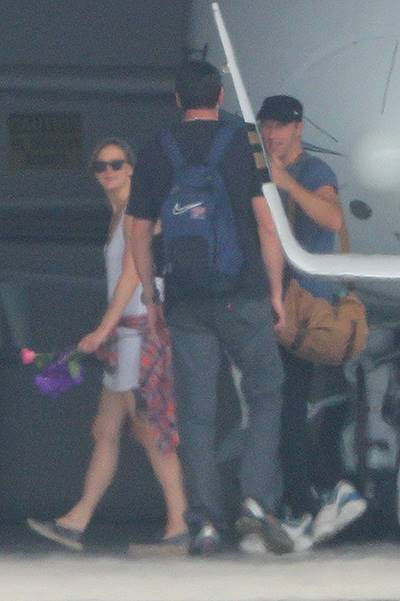 *EXCLUSIVE* Jennifer Lawrence and Chris Martin fly back to L.A. together in a private jet  **NO WEB FOR 24 HOURS, EMBARGO ENDS 10:30 AM PST ON 9/23/14**