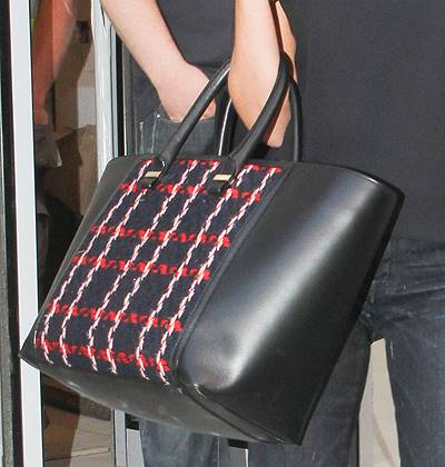 Victoria Beckham seen leaving her new Dover Street store Featuring: Victoria Beckham bag Where: London, United Kingdom When: 12 Sep 2014 Credit: WENN.com