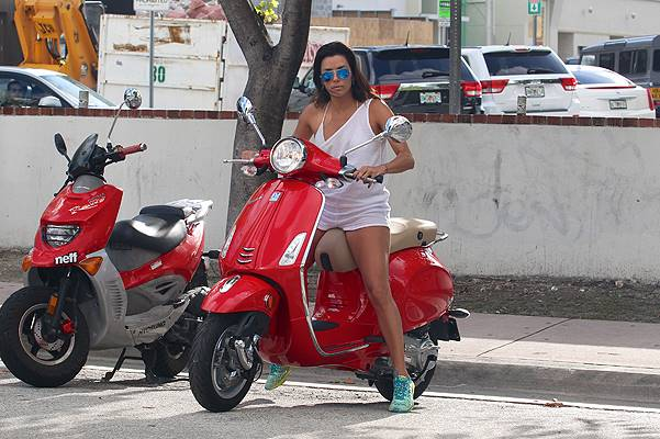Eva Longoria on a red vespa in Miami