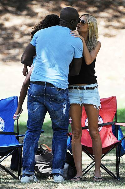 Heidi Klum kisses Seal as they are reunited spending a family day out in Brentwood, Los Angeles (BLURRED)