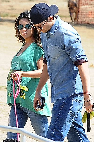 Pregnant, Mila Kunis and Ashton Kutcher seen taking their dogs to the dog park in Hollywood, CA on Saturday 092714