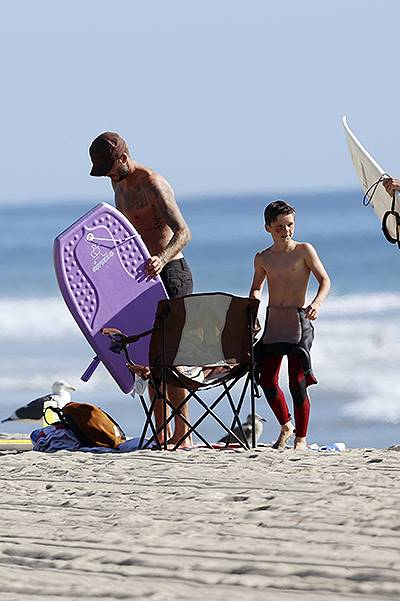 David Beckham takes his son to a surf lesson in Malibu