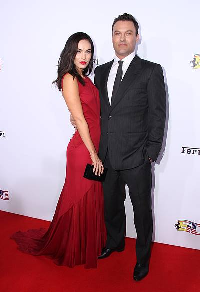 Megan Fox sizzles in a red gown, arriving in a Ferrari with husband Brian Austin Green