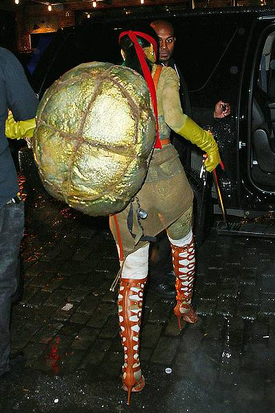 Rihanna dressed up as Raphael from Teenage Mutant Ninja Turtles out clubbing in the rain on Halloween night in NYC
