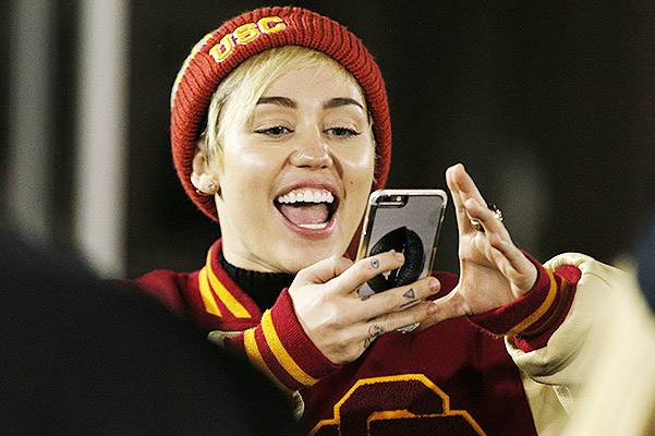 Miley Cyrus and Patrick Schwarzenegger sighting at USC football game
