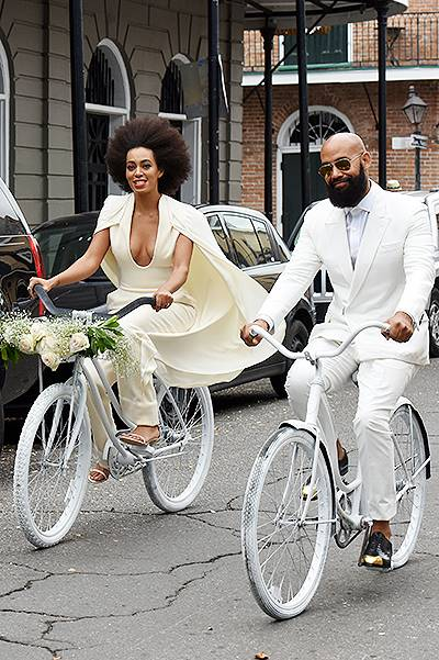 INF - Solange Knowles and her fiance Alan Ferguson ride bicycles all the way to their wedding at the Marigny Opera House in New Orleans