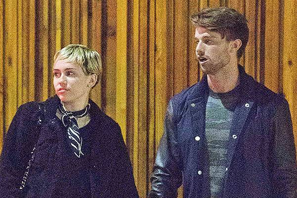 EXCLUSIVE: **PREMIUM RATES APPLY** Miley Cyrus meets Patrick Schwarzenegger's friends as they are spotted outside Mr Nice Guy in West Hollywood