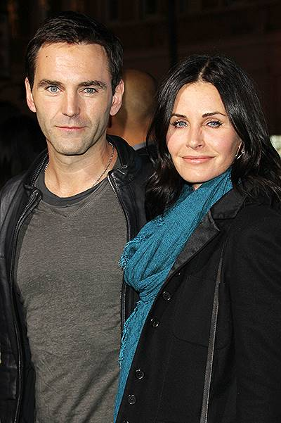 Los Angeles premiere of 'Horrible Bosses 2' at TCL Chinese Theatre - Arrivals Featuring: Courteney Cox, Johnny McDaid Where: Los Angeles, California, United States When: 20 Nov 2014 Credit: FayesVision/WENN.com