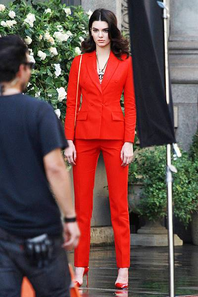 Kendall Jenner seen in a red suit for a photo shoot