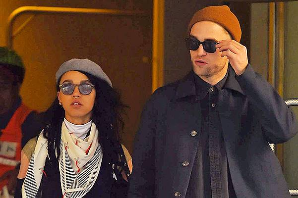 Robert Pattinson and his girlfriend FKA twigs get a taxi-cab in Midtown Manhattan